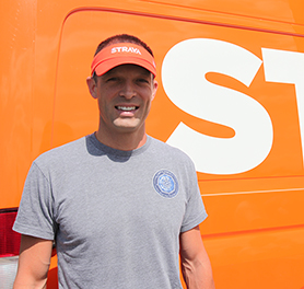 Photo of Jeff Miller in front of the Strava Sprinter Van