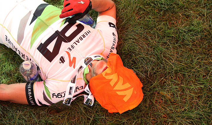 Photo of a cyclist with an orange Strava towel